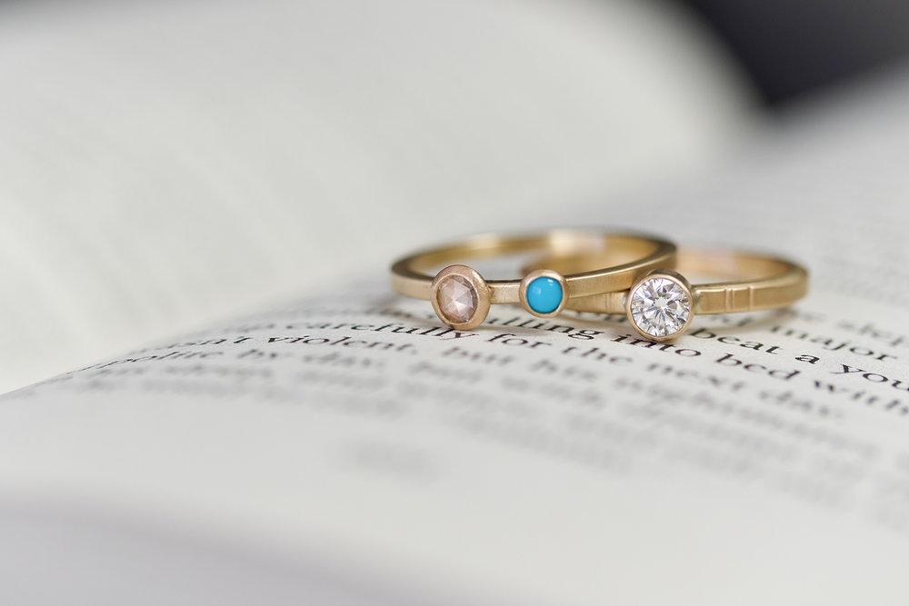 georgia and diamond granite rings on book small.jpg