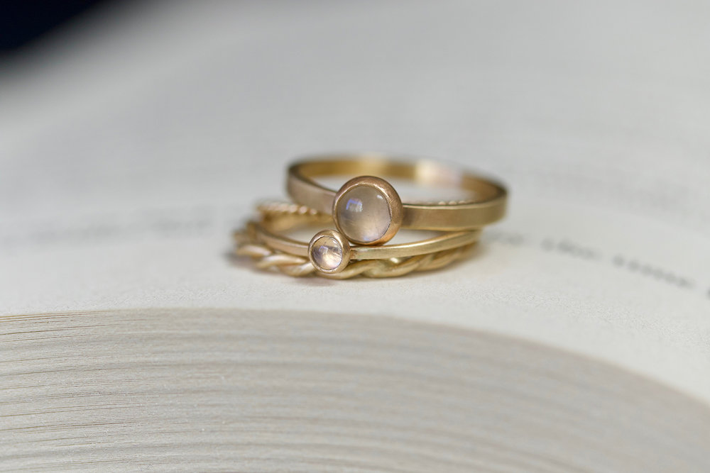 moonstone and rope rings on book small.jpg