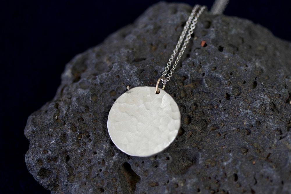 sol necklace on rock.jpg