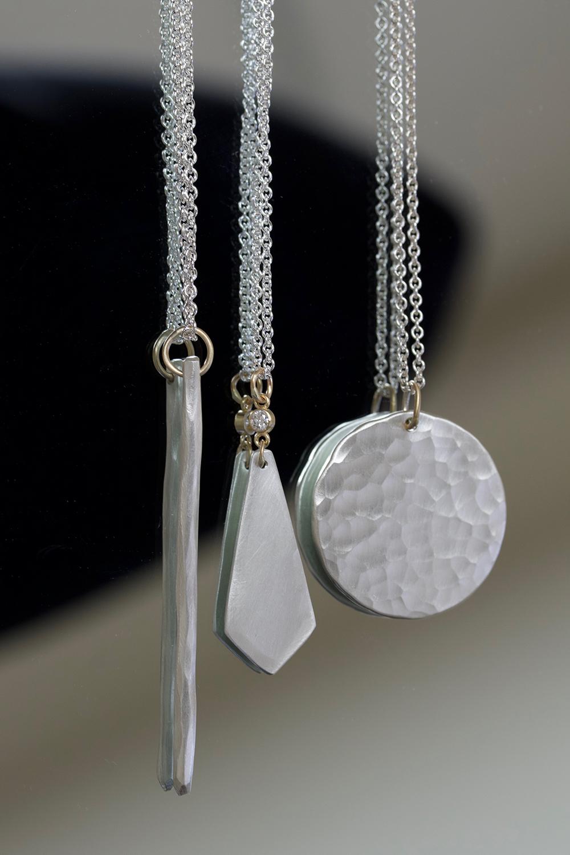 necklace trio on mirror.jpg