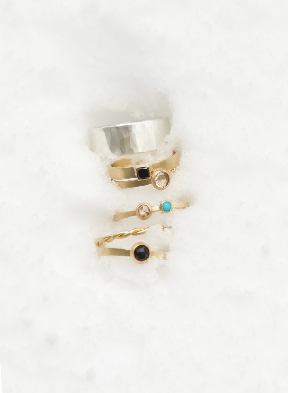 rings in the snow, on the Chamisa Trail. from top to bottom: the  8mm Mitla ,  Diamond Mesa ,  Katherine Rosecut Diamond ,  Georgia Diamond and Turquoise ,  Rope , and  Katherine Black Spinel .