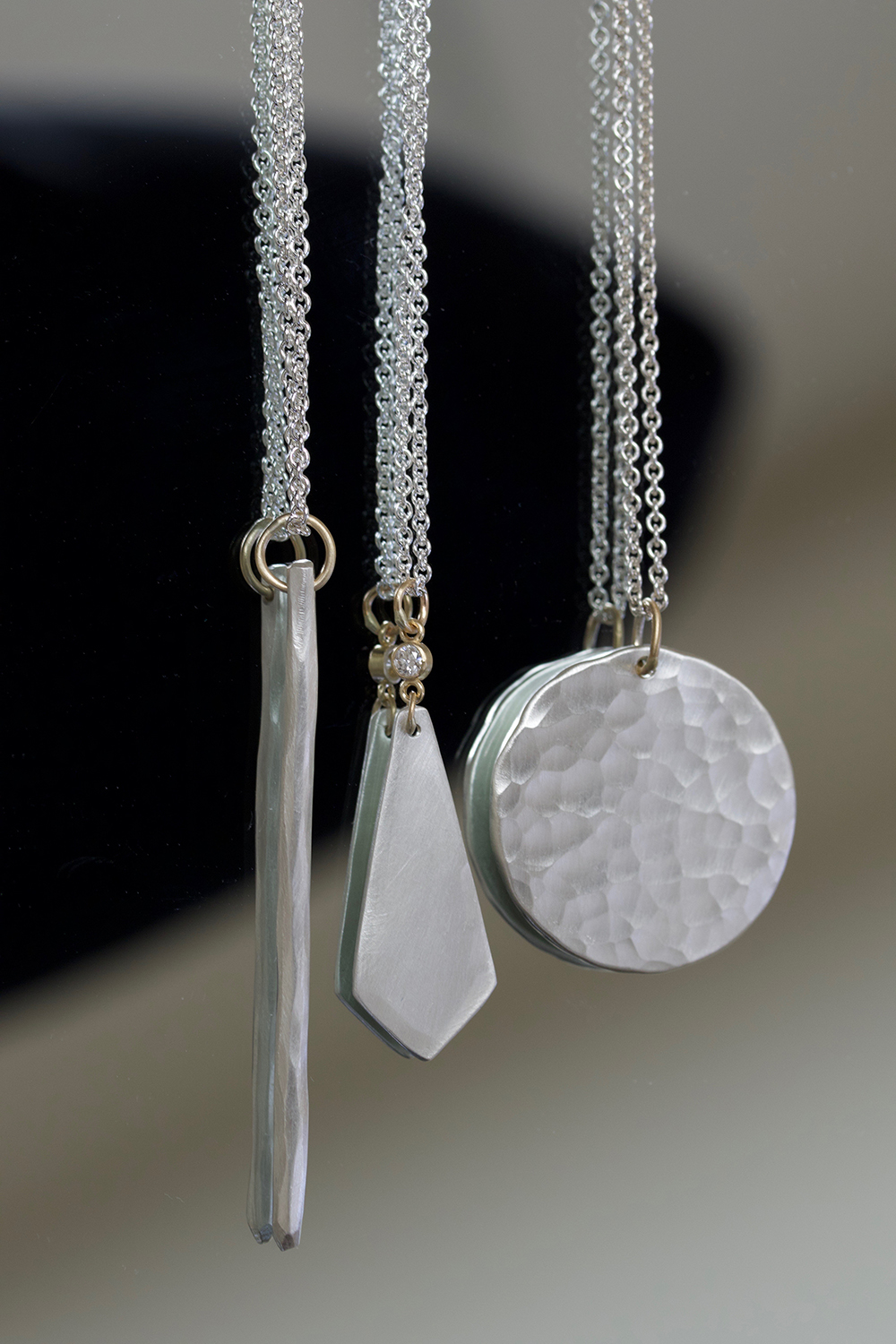 the  Aspen ,  St. Margarets Diamond Drop , and  Sol  necklaces in sterling silver and 14k yellow gold