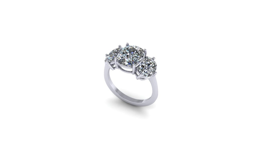 THREE STONE PLATINUM RING.jpg