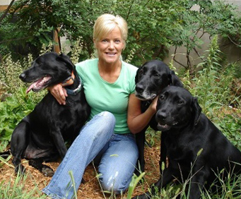 Paula with her black labs Dash, Briggs and Trae
