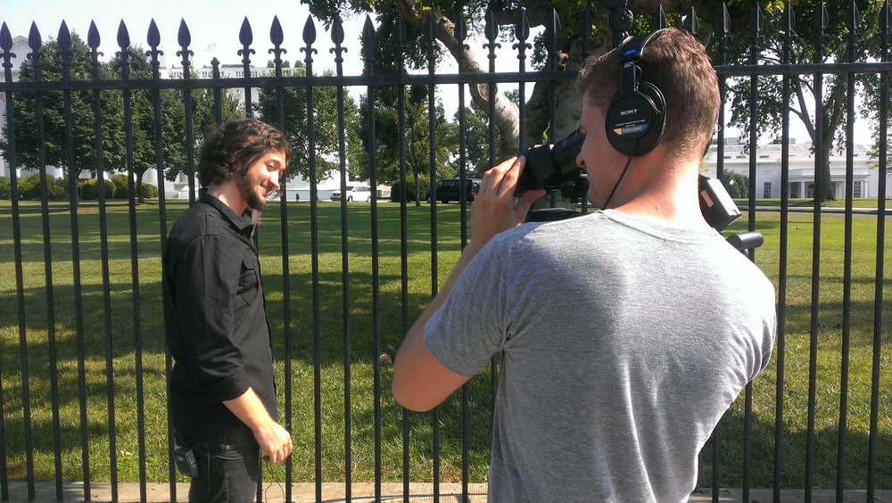Travis Burgess and Lee Camp in front of the White House.