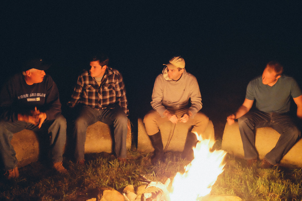 Dennis, Taylor, Scott, and Andy hanging by the campfire.