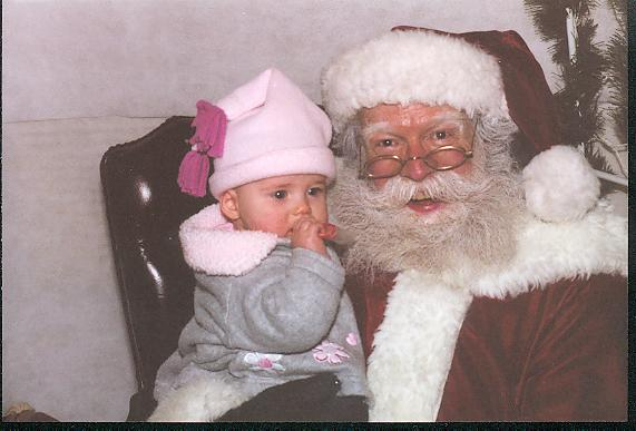 OUr daughter's first visit with Santa. At Seven Months old, she wasn't quite sure who this guy was.