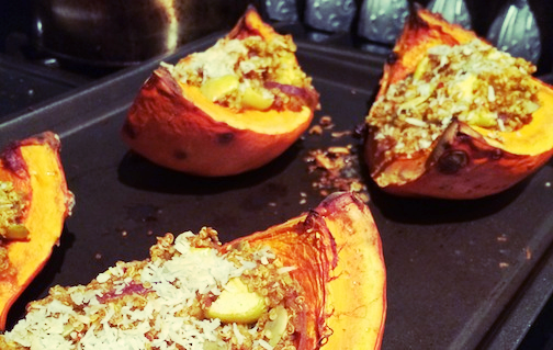 Squash stuffed with quinoa, apples, sunflower seeds and topped with coconut. Damn good.