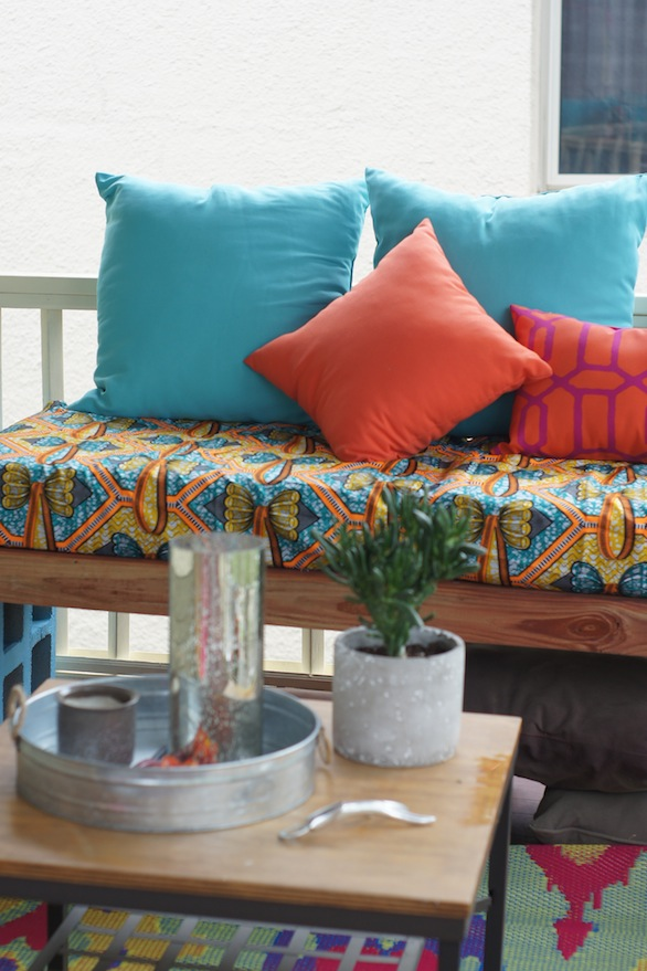 The rug really ties the room together. | How to Make an Awesome Outdoor Space on a Budget