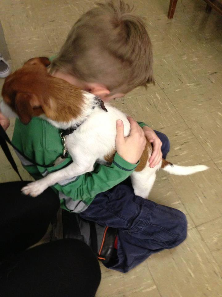 Rascal giving hugs to a young boy who recently experienced trauma at home. *Cue my heart exploding!