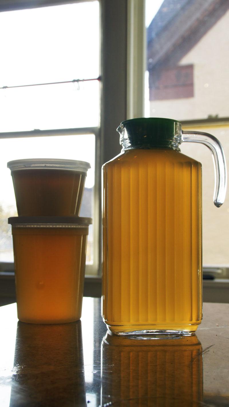 Bone broth, stored in a convenient pitcher.