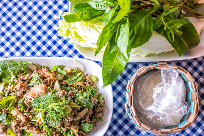 Laap Muu Khua Phrae, a spicy minced pork salad should be ordered with sticky rice. (Photo Credit:  Eater )
