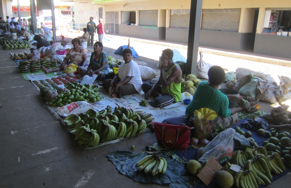 Local vendors sell fresh fish and produce in Nadi's open air market. (Photo credit: Cherri Megasko)