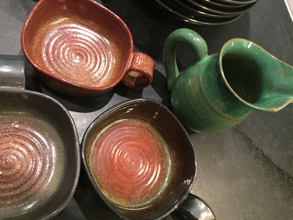 Traditionalshapes and glazes of the now highly collectible RowantreePottery.