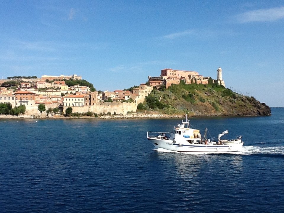 Entering Portoferrario in Elba. Napoleon's main residence is the yellow villa in the center.