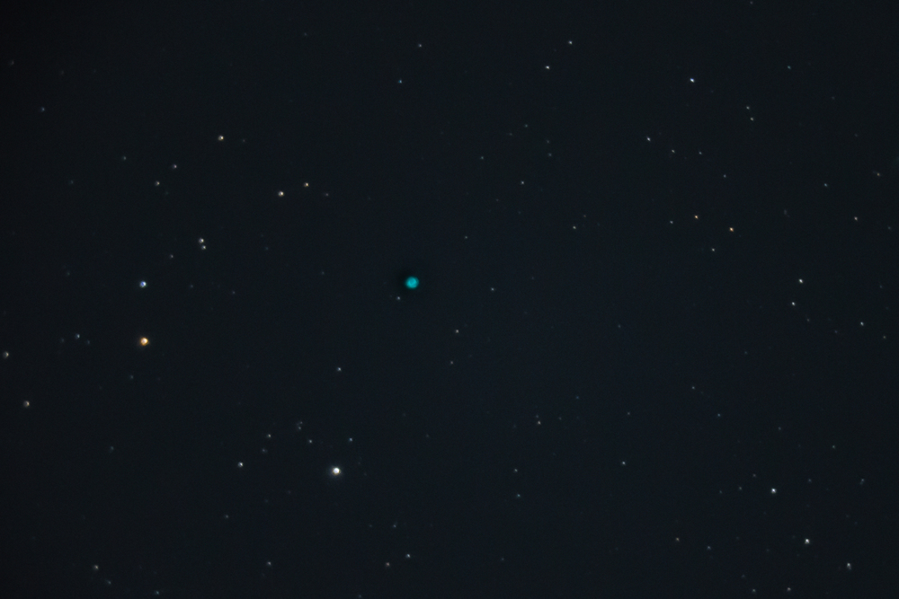 Too far for my scope, but the little blue dot is the Cat's Eye Nebula.