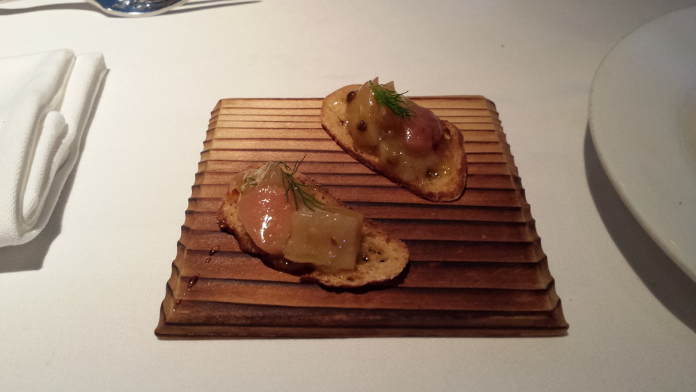 Amuse-Bouche - thin cracker with fruits.