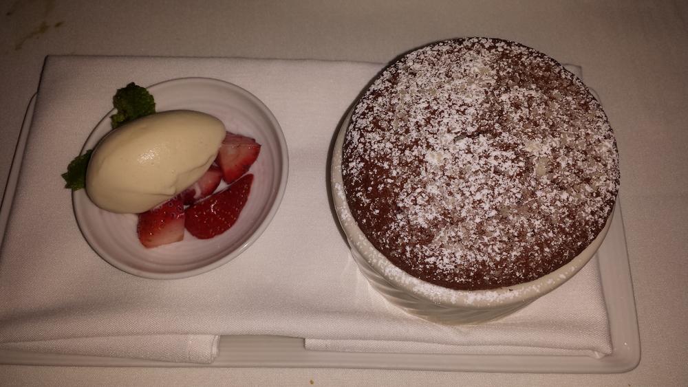 Manjari Dark Chocolate Soufflé -port cherries, caraway-vanilla ice cream. $14