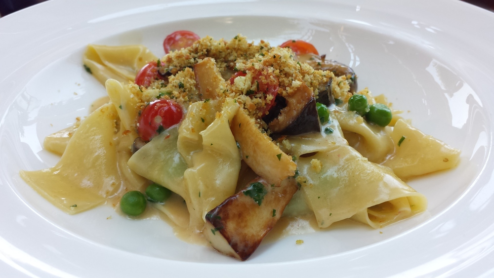 Pappardelle with cherry tomatoes, english peas, and king mushrooms.  $18