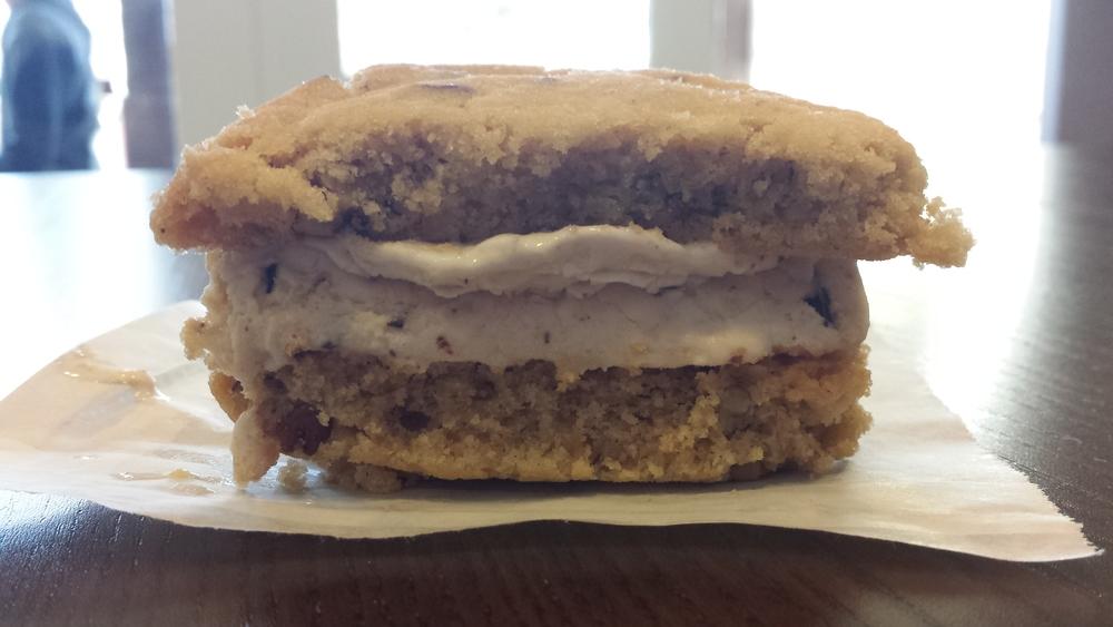 Halved Peanut Butter Twist Lemon Pecan Cookie Ice Cream Sandwich.