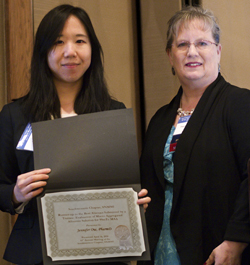 Jennifer OW was presented with a trainee award by Twyla Bartel