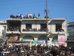 Toeschouwers op het dak