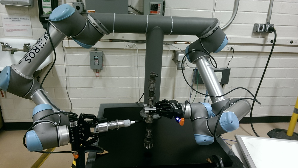 A dual arm manipulator built from two  UR5s  and two  Robotiq grippers  was built.  The system allows researchers to experiment with various assembly T&E tasks.