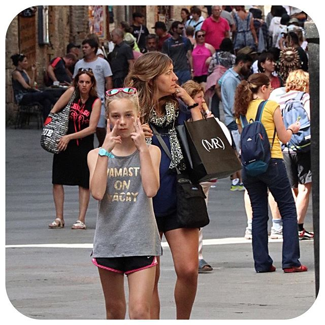 I don't know why but this candid pic is one of my favorite shots of the trip!  The hustle and bustle of Florence, me with my shopping bag looking for the next treasure and Ava, always looking cool. #travel #italy #iwanttogoback #candid #florence