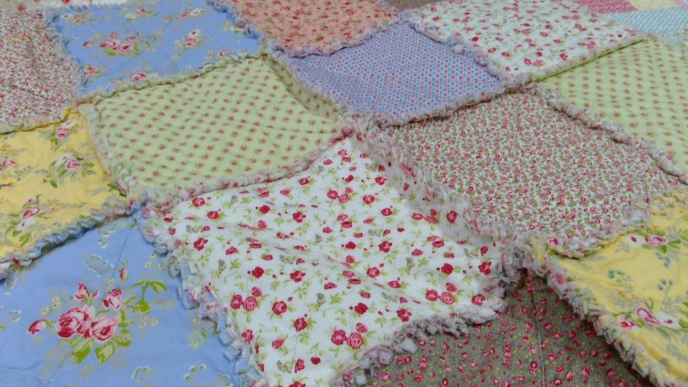 Make a rag quilt with cotton prints.  Now this is where the shabby part really comes in.  The pretty prints give the chic look.