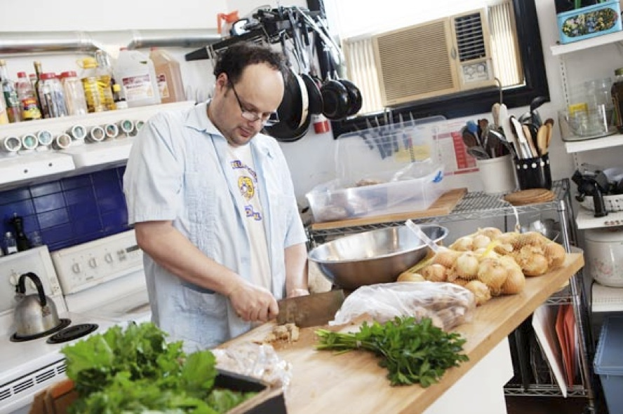 Len Senater working in the upper kitchen at his Depanneur food hub.