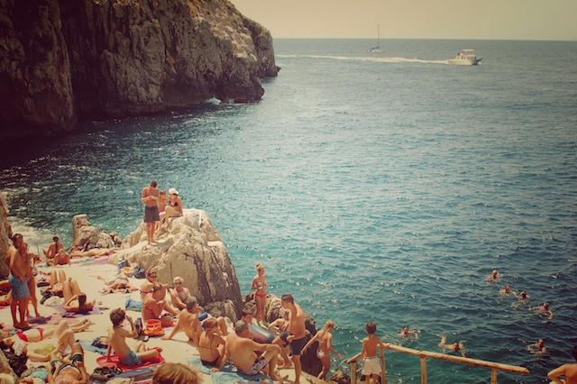 Sunbathing 60's. Capri, Italy.