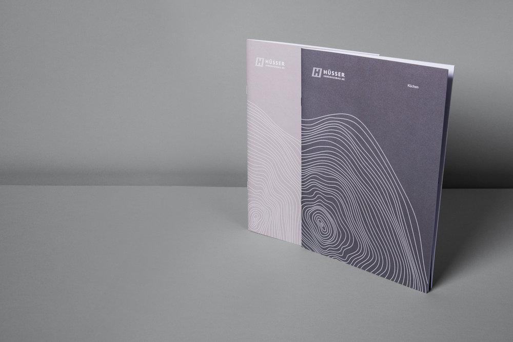 Huesser-Broschuere-Cover.jpg
