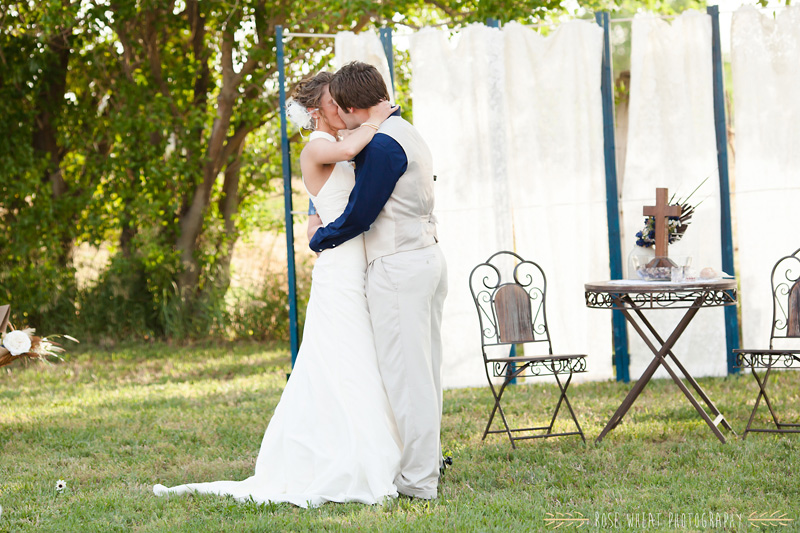 31.+bride_groom_kiss_aisle-1.jpg