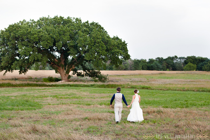 33.+bride_groom_walking_tree_field_country_wedding.jpg