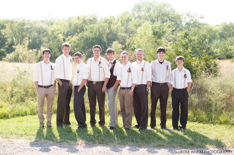 38. groomsmen_suspenders_feathers.jpg