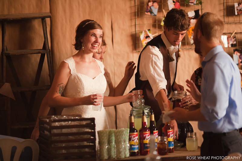 55. bride_groom_serving_guests.jpg