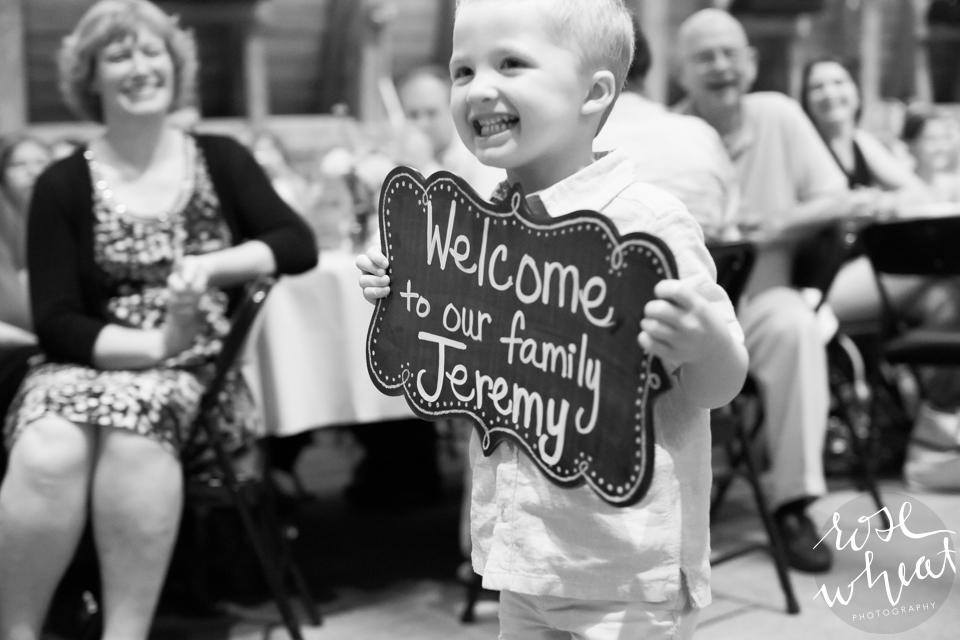 013. Thompson_Barn_Wedding_Ceremony_Sign_Ring_Bearer.jpg