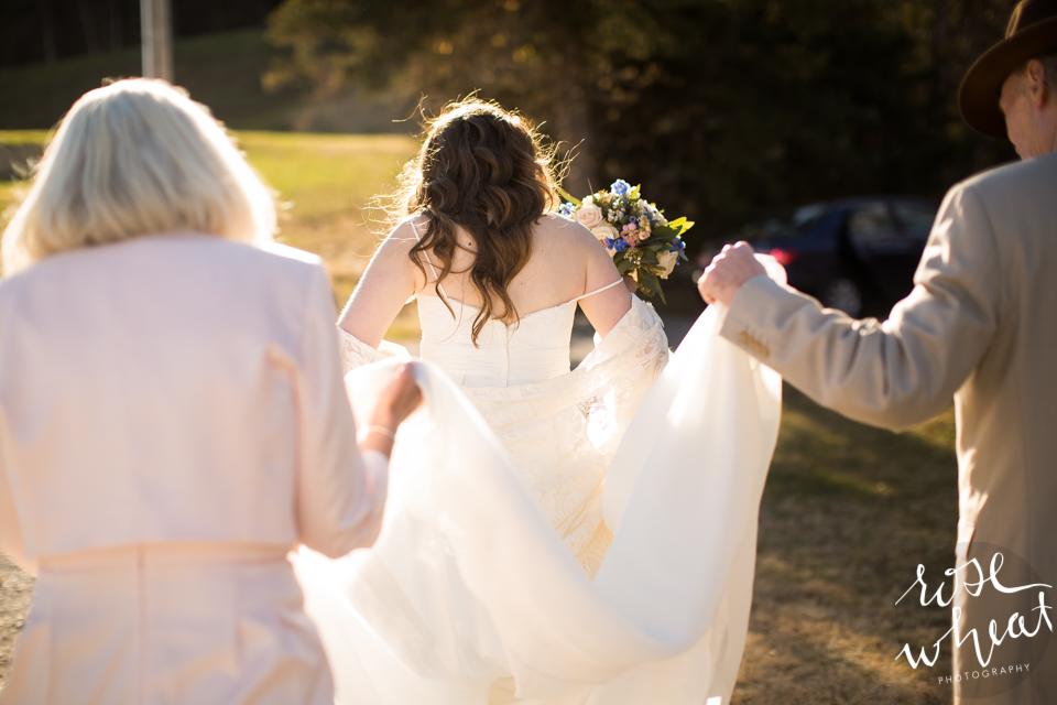 010. Parents_Carry_Bride's_Dress.jpg