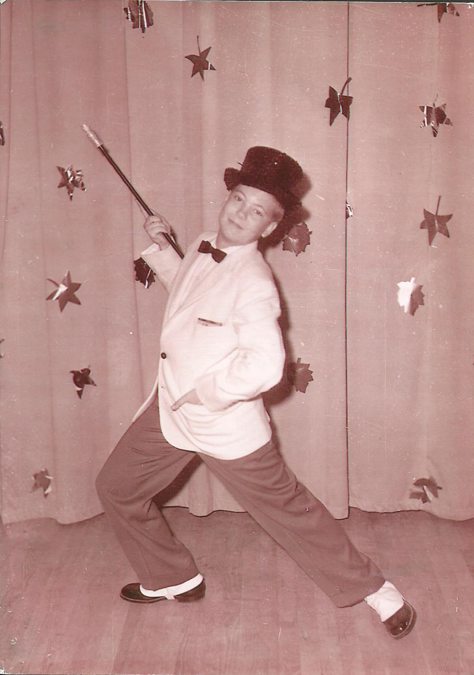 "My father looking dapper as he tap dances to ""Putting on the Ritz"" at his high school talent show."