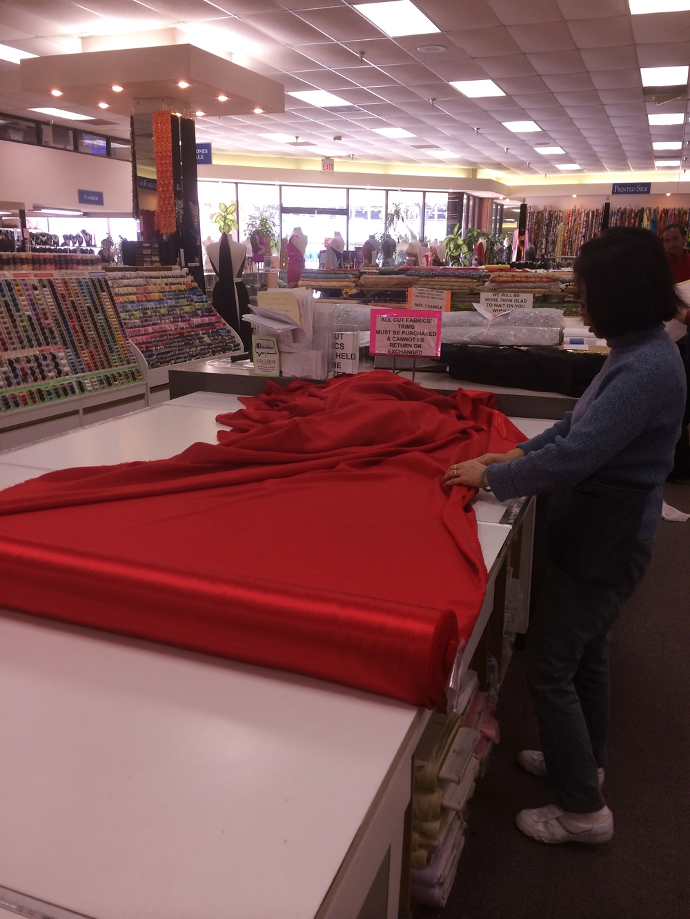 Rolling out yards and yards of red for our next collection