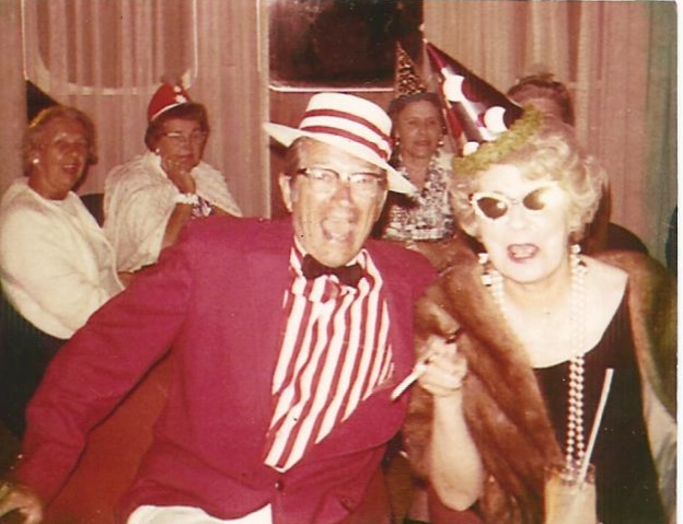 My grandfather, on a cruise with my grandmother wearing his signature red.