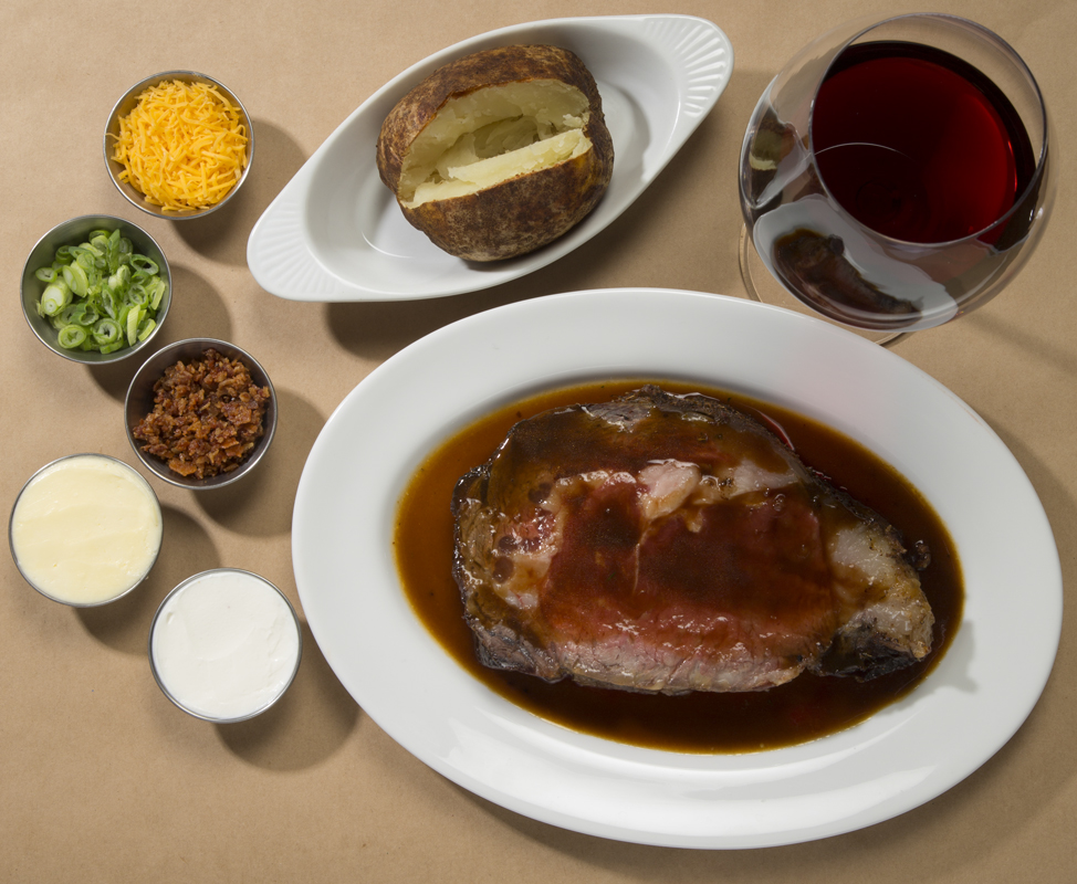 King cut prime rib is juicy and succulent with all fully loaded baked potato, creamy horseradish and au jus.