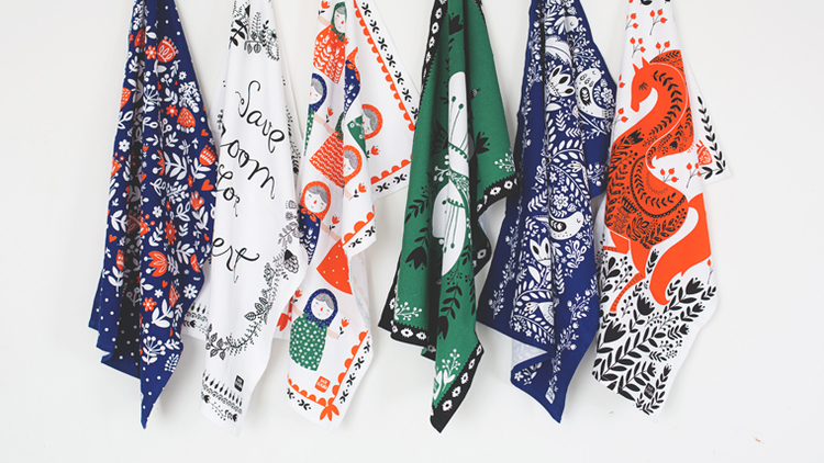 A selection of tea towels designed by Mirdinara Kitchen. Photo from their website by Aziza Mirtalipova.