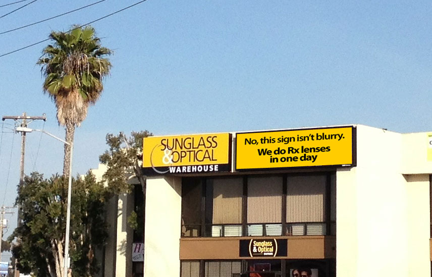 Electronic billboard facing the 8 freeway traveling east. Raising awareness about their optical services.