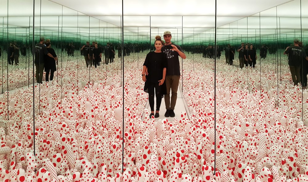 Yayoi Kusama,  Infinity Mirror Room—Phalli's Field  (1965/2016), the artist's milestone installation. A dense and dizzying field of hundreds of red-spotted phallic tubers in a room lined with mirrors.