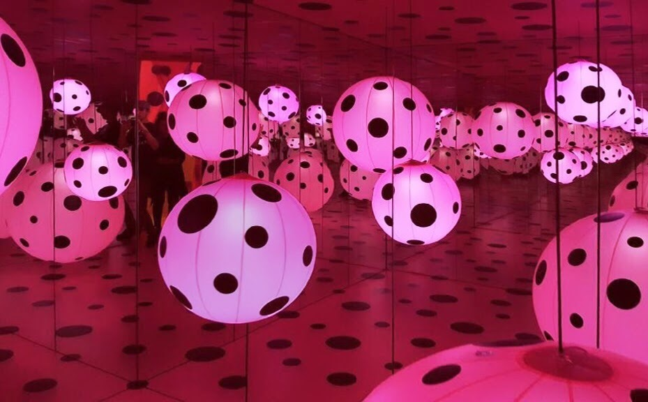 Yayoi Kusama,  Dots Obsession—Love Transformed into Dots  (2009), Kusama's signature bold polka dots are featured in a domed mirror room surrounded by inflatables suspended from the ceiling.