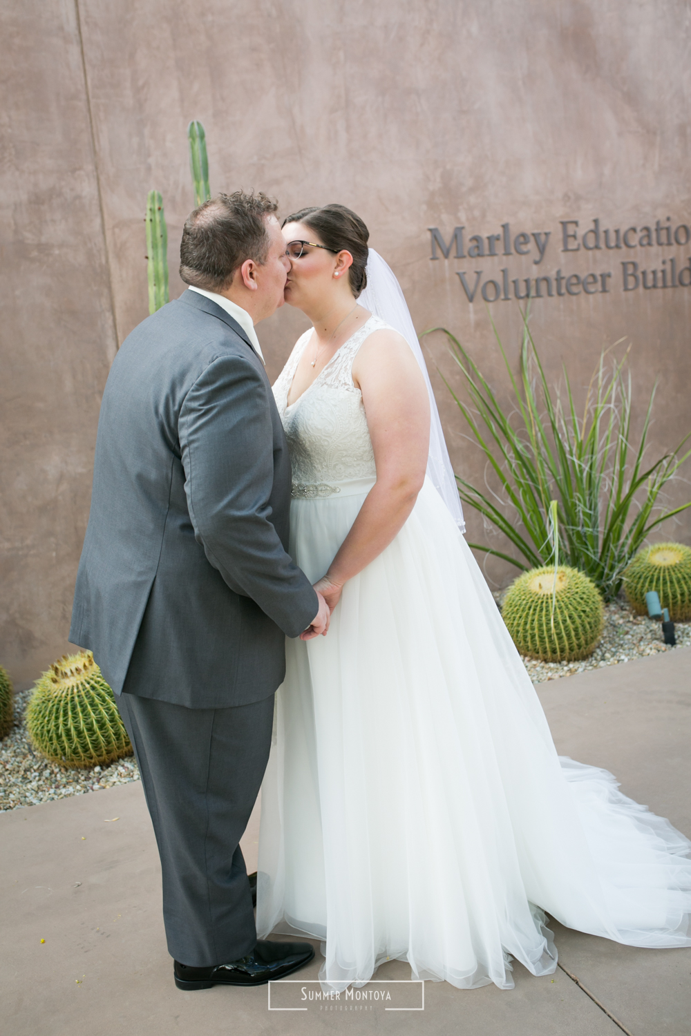 Bride and groom kissing at the Desert Botanical Gardens