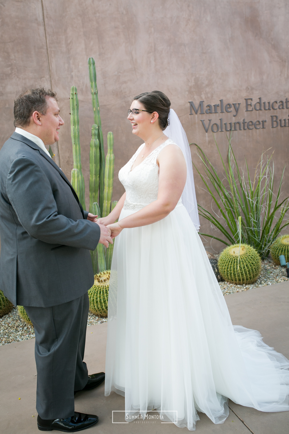 Bride and groom first look at a Phoenix wedding at the Desert Botanical Gardens