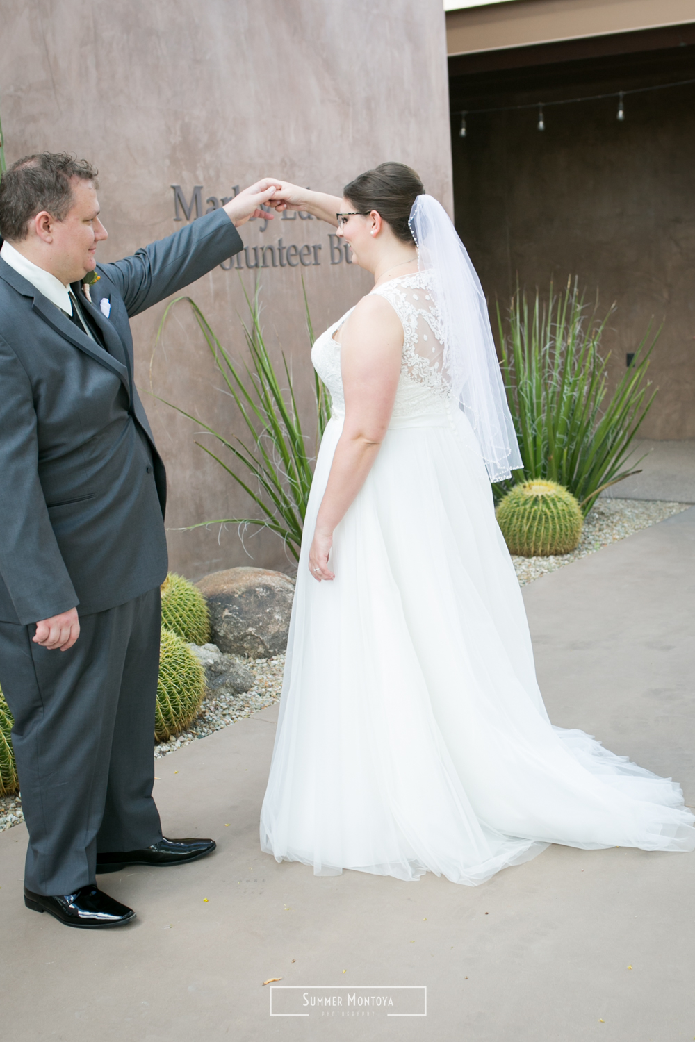 Groom twirling his bride at the Desert Botanical Gardens