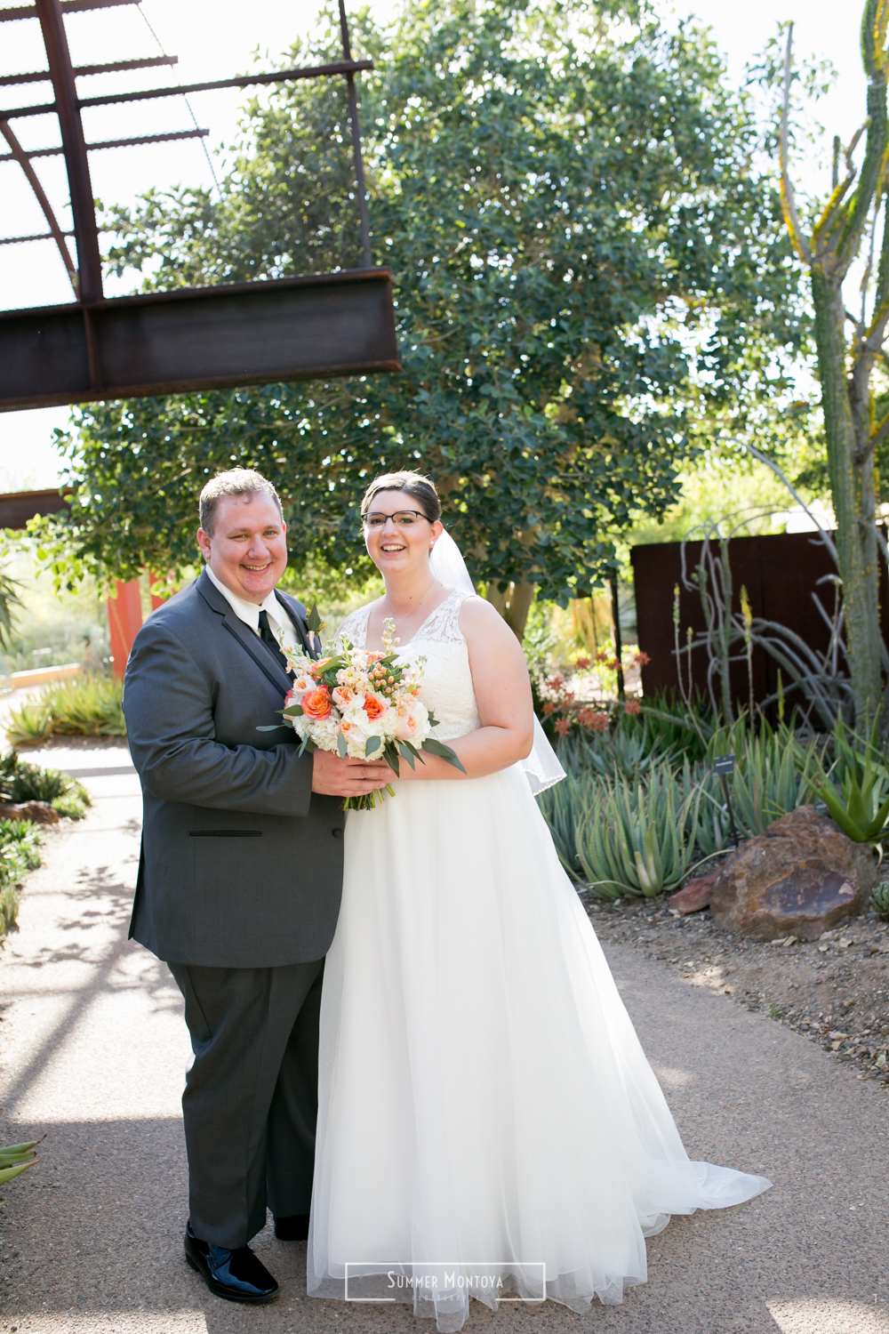Bride and groom smiling at their Phoenix wedding at the Desert Botanical Gardens